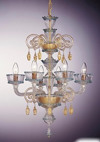 Chandelier with gold decoration at three lights