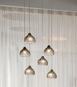 Modern suspended lamp in amber color