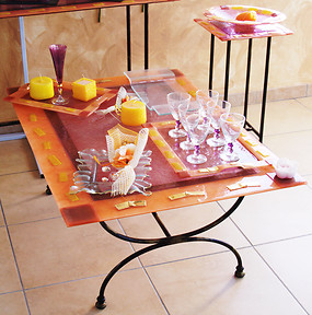 Glass table in salmon color with gold cards