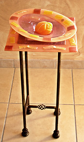 Telephone stand in salmon color glass and gold tiles