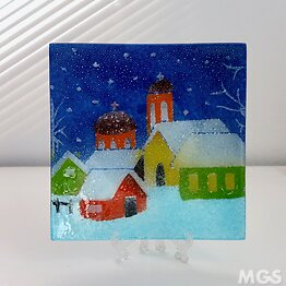 Multicolored glass tray with a snowy village
